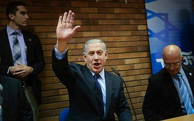 Prime Minister Benjamin Netanyahu arrives at a press conference in Tel Aviv on December 11, 2014. (Ben Kelmer/Flash90)