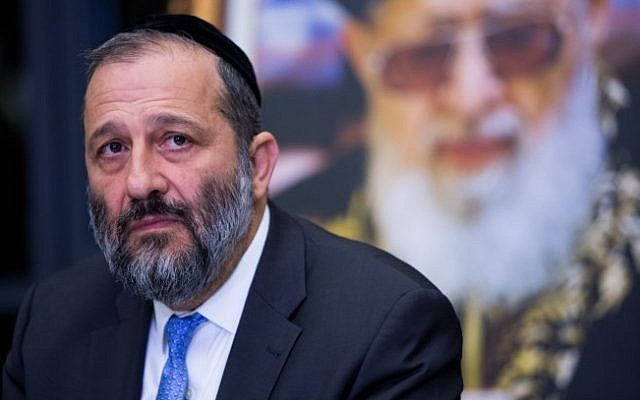 Shas chairman Aryeh Deri at a press conference in Jerusalem, December 14, 2014. Behind him is a poster of the party's late spiritual leader, Rabbi Ovadia Yosef. (photo credit: Yonatan Sindel/Flash90)