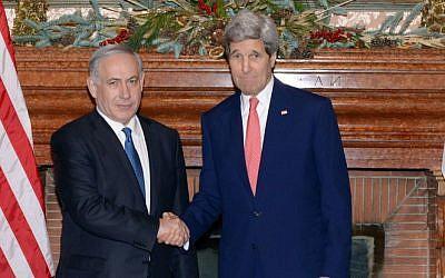 PM Benjamin Netanyahu (L) meets with US Secretary of State John Kerry in Rome on December 15, 2014 (photo credit: Amos Ben Gershom / GPO / Flash90)