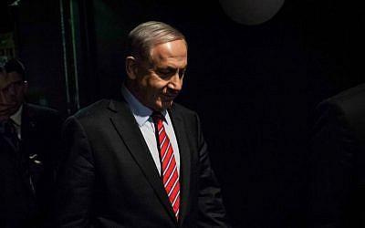 Prime Minister Benjamin Netanyahu arrives at a press conference for foreign media in Jerusalem, on December 17, 2014. (Emil Salman/POOL/FLASH90)
