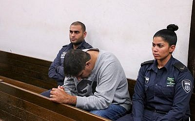 Hapoel Petah Tikva soccer team manager Ofer Tzabari arrives at his hearing at the Tel Aviv Magistrate's Court on December 17, 2014. (Photo credit: Flash 90)
