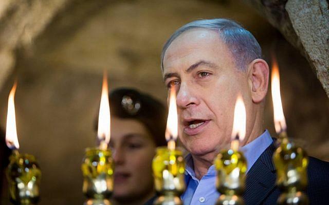 Prime Minister Benjamin Netanyahu speaks at Hanukkah ceremony at the Western Wall on December 20, 2014. (Photo credit: Yonatan Sindel/Flash90)
