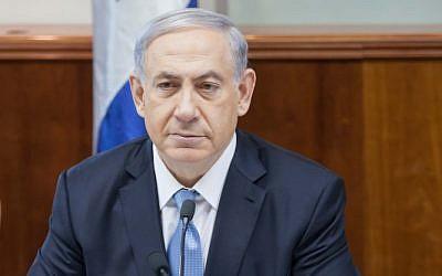 Prime Minister Benjamin Netanyahu at the weekly cabinet meeting, December 21, 2014 (photo credit: Emil Salman/pool)