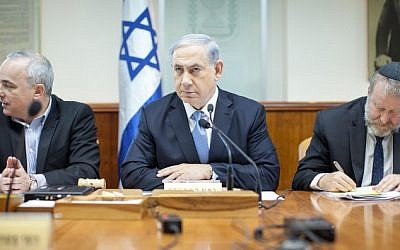Prime Minister Benjamin Netanyahu speaks during the weekly cabinet meeting, at the Prime Ministers Office in Jerusalem, December 21, 2014. (photo credit: Emil Salman/POOL)