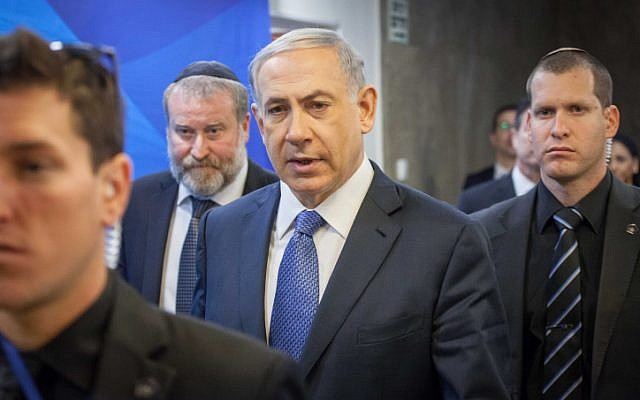 Prime Minister Benjamin Netanyahu arrives to the weekly cabinet meeting on Sunday, December 28, 2014. (photo credit: Emil Salman/POOL)
