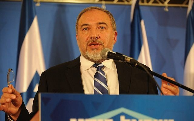 Leader of the Yisrael Beytenu political party and Minister of Foreign Affairs Avigdor Liberman speaks at a conference of Yisrael Beytenu activists in Ariel, on December 30, 2014. (photo credit: Gili Yaari/FLASH90)
