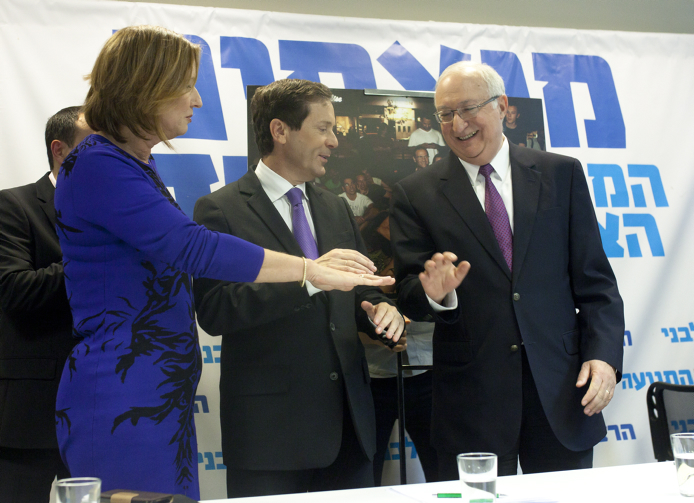 Hatnua party leader Tzipi Livni (left), Labor Party leader Isaac Herzog (center) and noted economics reformer Professor Manuel Trajtenberg at a press conference on December 31, 2014 announcing Trajtenberg's participation in the joint Labor-Hatnua list for the upcoming March 2015 Knesset elections. (photo credit: Amir Levy/Flash90)