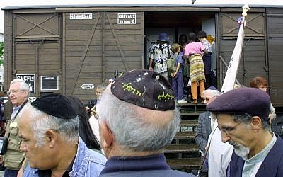 This Monday Aug. 20, 2001, file photo shows French Holocaust survivors gathering at the site of the former Drancy detention camp, north of Paris, France. From Aug. 20, 1941 until the end of World War II, more than 70,000 Jewish men, women and children passed through Drancy on their way to Nazi extermination camps, particularly Auschwitz. (AP Photo/Michel Euler)