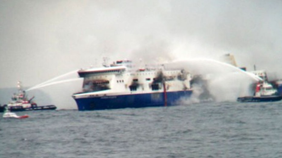 In this photo taken from a nearby ship, vessels try to extinguish the fire on the Italian-flagged Norman Atlantic in the Adriatic Sea, Sunday, Dec. 28, 2014. (photo credit: AP Photo/SKAI TV Station)