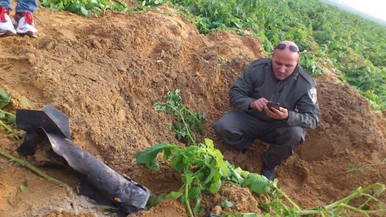A rocket fired from the Gaza Strip on Friday, December 19, 2014, lands in an open area in the Eshkol region. (Photo credit: Israel Police)