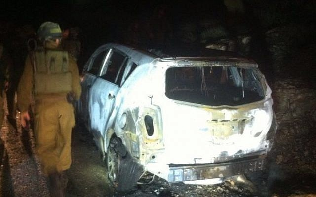 A car destroyed after it was hit by a Molotov cocktail on December 25, 2014 in the West Bank. Ayala Shapira, 11, was seriously injured, while her father, Avner, sustained light injuries. (photo credit: Judea and Samaria Fire Department)