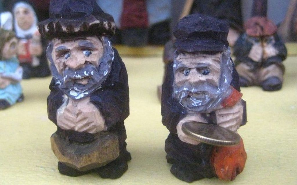 Ryszard Kucharski's carved Lucky Jew miniatures on display in Warsaw (photo credit: Ilan Ben Zion/Times of Israel staff)