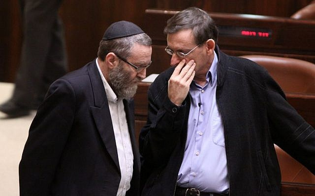 United Torah Judaism MK Moshe Gafni (L) speaks to Hadash MK Dov Khenin (R) at the Knesset on December 3, 2014. (photo credit: Courtesy)