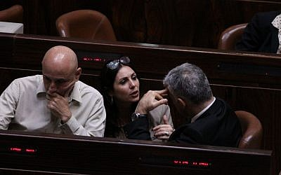 Likud MK Miri Regev (C) speaks to Yesh Atid MK Yair Lapid (R) at the Knesset on December 3, 2014. (photo credit: Courtesy)