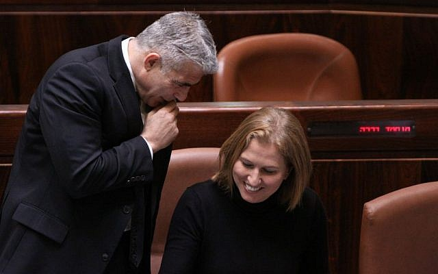 Yesh Atid leader Yair Lapid (left) and Hatnua leader Tzipi Livni at the Knesset, December 3, 2014. (Courtesy)