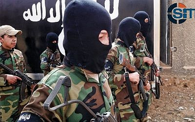 """Cubs of the Caliphate."" Children are seen receiving military training by Islamic State militants in a camp near Damascus, Syria, December 6, 2014. (photo credit: SITE Intel Group)"
