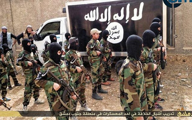 """""""Cubs of the Caliphate."""" Children are seen receiving military training by Islamic State militants in a camp near Damascus, Syria, December 6, 2014. (photo credit: SITE Intel Group)"""