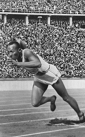 Jesse Owens starts the 200 meters sprint at the 1936 Berlin Olympics photo credit: Wikipedia)