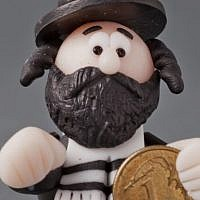 A Lucky Jew figurine holding a coin, 2013, maker unknown (photo credit: Grzegorz Mart)
