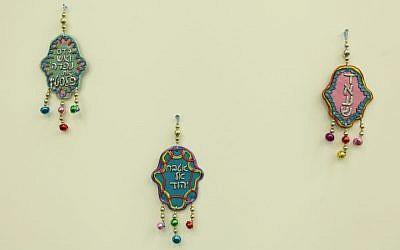 Three controversial 'hamsa' talismans produced by artist Gal Volinez, December 2014. (photo credit: Sapir College/Liron Buzaglo)