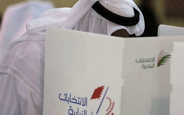 A Bahraini man votes in Manama, Bahrain, Saturday, Nov. 29, 2014. Bahraini voters are returning to the polls Saturday for a runoff election being boycotted by the opposition for the country's first new parliament since widespread Arab Spring-inspired protests nearly four years ago. (photo credit: AP/Hasan Jamali)