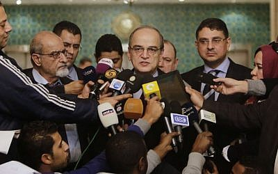 Hadi Bahra (C), the head of the Syrian National Coalition, the country's main political opposition group, speaks during a press conference in Cairo, Egypt, Saturday, Dec. 27, 2014. (photo credit: AP/Amr Nabil)