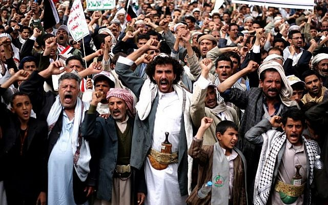 In this Thursday, October 9, 2014 file photo, Houthi Shiite rebels chant slogans during a protest near the site of a suicide bombing in Sanaa, Yemen.  (Photo credit: AP/Abdullrhman Huwais, File)