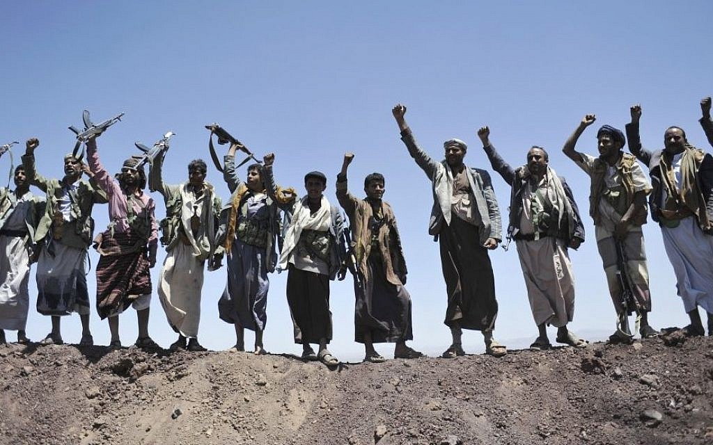 In this September 22, 2014 file photo, Hawthi Shiite rebels chant slogans at the compound of the army's First Armored Division, after they took it over, in Sanaa, Yemen. (Photo credit:AP/Hani Mohammed, File)