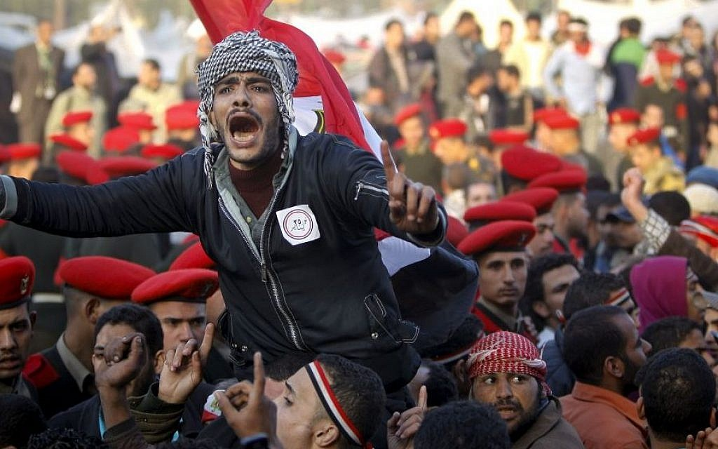 Egyptian protesters are surrounded by army soldiers trying to lead them away from Tahrir Square in Cairo, Egypt, February 13, 2011. (photo credit: AP/Tara Todras-Whitehill, File)