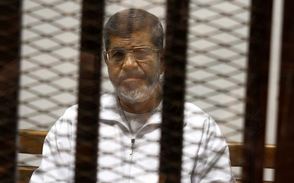 In this May 8, 2014 file photo, Egypt's ousted Islamist President Mohammed Morsi sits in a defendant cage in the Police Academy courthouse in Cairo, Egypt. (AP/Tarek el-Gabbas, File)