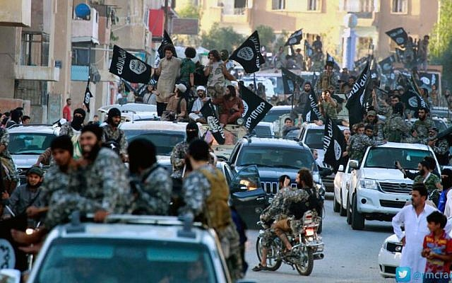 Fighters from Islamic State parade in Raqqa, northern Syria in 2014. (AP/Raqqa Media Center of the Islamic State group)
