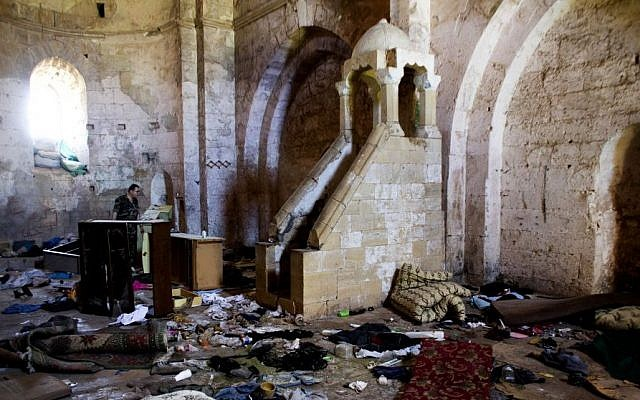 Belongings of Syrian rebels inside a chapel at Crac des Chevaliers, the world's best preserved medieval Crusader castle, Thursday, May 1, 2014, Syria. (photo credit: AP/Dusan Vranic, File)