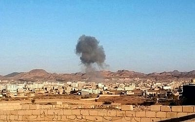 Smoke rises from the site of a car bomb explosion in Radda town,100 miles (160 kilometers) south of the capital Sanaa, Yemen, Tuesday, Dec. 16, 2014. (Photo credit: AP)