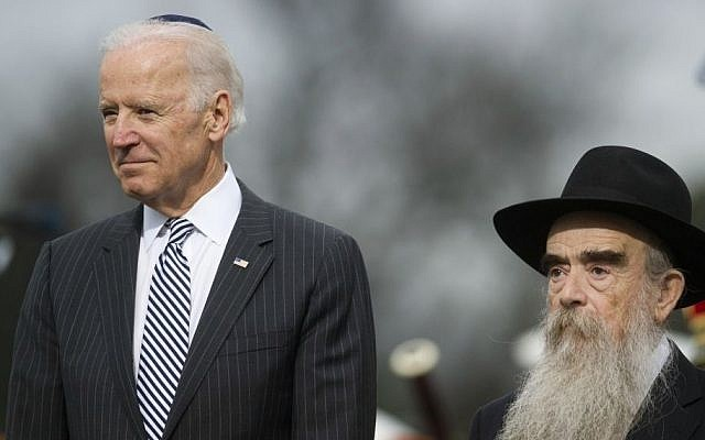Vice President Joe Biden stands beside Rabbi Levi Shemtov, executive vice president of American Friends of Lubavitch (Chabab) as the National Menorah is lit during a ceremony marking the start of the celebration of Hanukkah, on the Ellipse near the White House in Washington, Tuesday, Dec. 16, 2014. (Photo credit: AP/Cliff Owen)