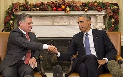 President Barack Obama shakes hands with Jordan's King Abdullah II during their meeting in the Oval Office of the White House in Washington, Friday, Dec. 5, 2014. (AP Photo/Jacquelyn Martin)