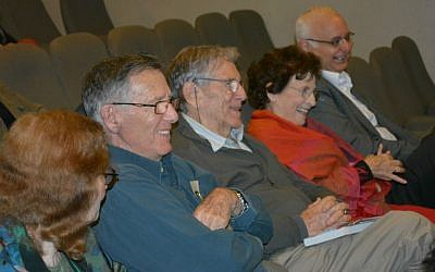 Author Amos Oz  (center) and family watching the film documenting daughter Fania Oz-Salzberger's roots tour to Ukraine, Dec. 10, 2014. (Olga Noa Lavie /Limmud)