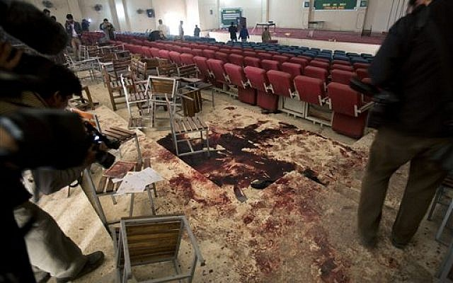 Pakistani video journalists film inside the auditorium of an Army Public School a day after an attack by the Taliban, in Peshawar, Pakistan, Wednesday, Dec. 17, 2014. (photo credit: AP Photo/B.K. Bangash)