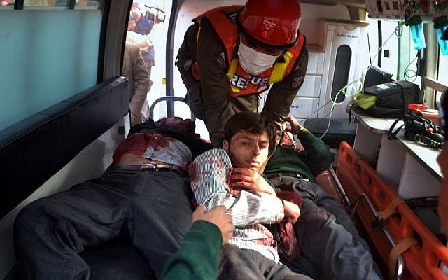 Pakistani rescue workers remove students from an ambulance after they were injured in a shootout at a school under attack by Taliban gunmen, in Peshawar, Pakistan, Tuesday, Dec. 16, 2014. (photo credit: AP/Mohammad Sajjad)