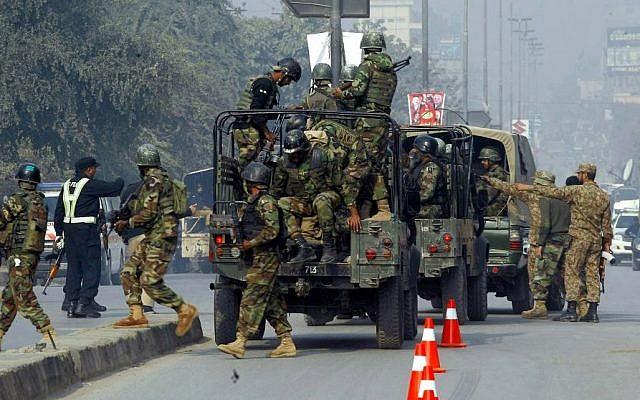 Pakistani army troops arrive to conduct an operation at a school under attack by Taliban gunmen in Peshawar, Pakistan, Dec. 16, 2014. (photo credit: AP/Mohammad Sajjad)