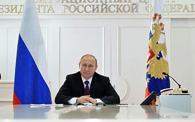 Russian President Vladimir Putin in Moscow's Kremlin, Russia, Friday, Dec. 26, 2014. (AP/RIA Novosti, Alexei Druzhinin, Presidential Press Service)
