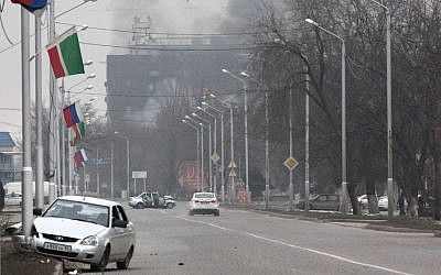 Smoke rises from a publishing house in the center of Grozny, Russia, early Thursday, Dec. 4, 2014. (photo credit: AP/Musa Sadulayev)