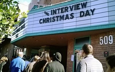 Patrons waiting in line to see 'The Interview' at the Valley Art theater in Tempe, Arizona, December 25, 2014. (photo credit: AP/Alina Hartounian)