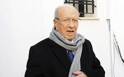 President Beji Caid Essebsi, an 88-year-old former minister, leaves his party headquarters in Tunis, December 22, 2014. (photo credit: AP/Hassene Dridi)