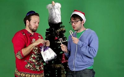Jews decorate a Christmas tree in Buzzfeed video. (YouTube screenshot)