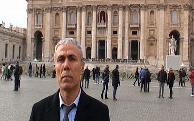 Ali Agca stands in front of St. Peter's Basilica at the Vatican, Saturday, Dec. 27, 2014. The Turkish gunman who shot and wounded John Paul II in 1981 laid white flowers Saturday on the saint's tomb in St. Peter's Basilica (photo credit: AP/Adnkronos International, ho)