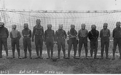 A World War I British soccer team with gas masks, 1916 (photo ccredit: Agence Rol - Bibliothèque nationale de France/ Wikipedia)