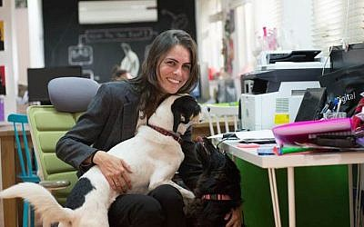 Wooof CEO Yael Broitman, with her own dog (Photo credit: Courtesy)