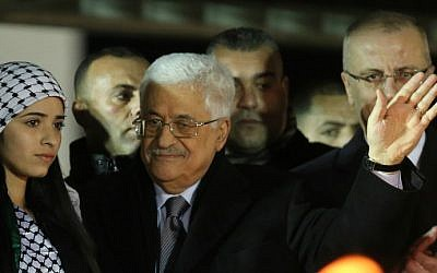 Palestinian Authority President Mahmoud Abbas waves to the crowd during a gathering to celebrate the 50th anniversary of the Fatah movement, in the West Bank city of Ramallah on December 31, 2014. (photo credit: AFP/Abbas Momani)