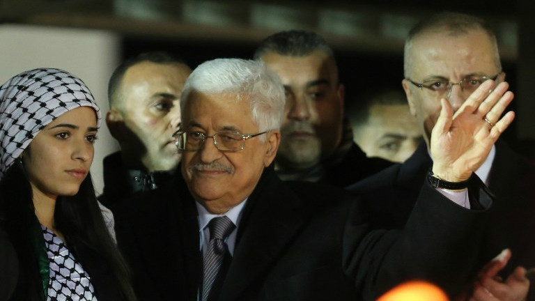 Palestinian Authority President Mahmoud Abbas  waves to the crowd during a gathering to celebrate the 50th anniversary of the start of the Fatah movement, in the West Bank city of Ramallah on December 31, 2014 (photo credit: AFP/ Abbas Momani)