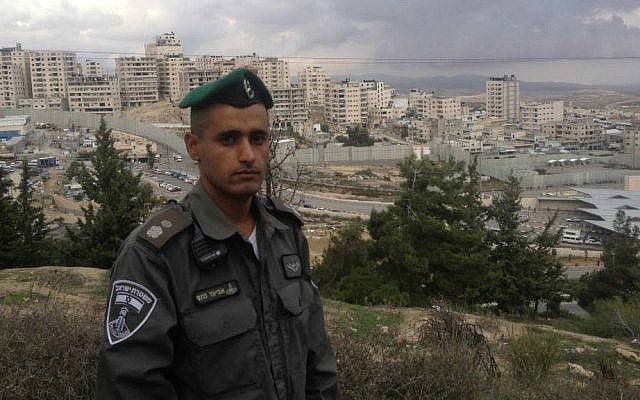 Chief Superintendant Aviad Ketafi, above the Shuafat Refugee Camp, during a November 25, 2014 tour of the city (photo credit: Mitch Ginsburg/ Times of Israel)
